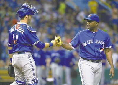 Jays reliever Darren Oliver is congratulated by catcher J.P. Arencibia after picking up the save.