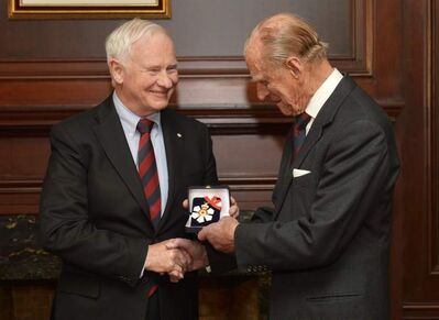 Prince  Philip (right) receives the insignia of  Companion of the Order of Canada from Gov. Gen. David Johnston in Toronto on Friday  during a brief visit to Canada.