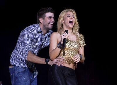 FILE - This May 29, 2011 file photo shows Colombia's singer Shakira performing with FC Barcelona soccer player Gerard Pique during The Sun Comes Out World Tour concert in Barcelona, Spain. It was announced on Wednesday, Jan. 23, 2013, that singer Sharika Mebarak and soccer player Gerard Pique have welcomed a baby son, Milan Piqu� Mebarak, born Tuesday, 22, in Barcelona, Spain. (AP Photo/Emilio Morenatti, File)