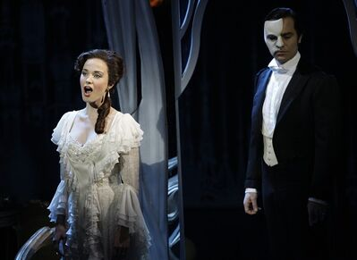"FILE - In this March 3, 2010, file photo, the Phantom, played by Ramin Karimloo, right, performs a scene with Christine, played by Sierra Boggess, from the sequel to The Phantom of the Opera, ""Love Never Dies"" at the Adelphi Theatre in central London. Producers will broadcast on Sunday a live performance of the original show ""The Phantom of the Opera"" from London's 5,500-seat Royal Albert Hall to movie houses in America, the UK, Europe, Canada, Japan and Australia. The live performance _ one of three shows at the hall _ will be followed by rebroadcasts to cinemas on Oct. 5, 6 and 11. (AP Photo/Joel Ryan, file)"