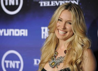"""Sarah Carter, a cast member in """"Falling Skies,"""" poses at the premiere screening of the TNT series in 2011."""