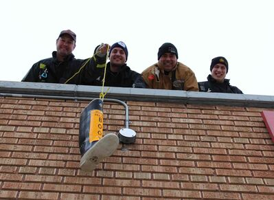 From Left: Chad Swayze, Ben Ritchie, Alan Bartley, and Mike Lisowick are on the roof of the Osborne Village Fire Station for 72 hours to raise money for Muscular Dystrophy.