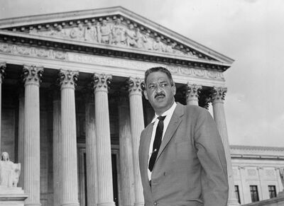 FILE - This Aug. 22, 1958 file photo shows Thurgood Marshall outside the Supreme Court in Washington. From the time Americans roll out of bed in the morning until they turn in, and even who they might be spending the night with, the court's rulings are woven into daily life in ways large and small.(AP Photo, File)