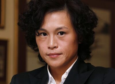 """In this Thursday, Sept. 27, 2012 photo, Gigi Chao, daughter of Hong Kong property tycoon Cecil Chao, poses during an interview in Hong Kong. The daughter of the prominent Hong Kong tycoon who has offered $65 million to any man who can woo her away from her lesbian partner says she's not upset with her father. Gigi Chao says she's on """"very loving terms"""" with her father. He made world headlines this week when he offered the 500 million Hong Kong dollar marriage bounty after learning that his daughter had eloped with her partner to France. (AP Photo/Kin Cheung)"""