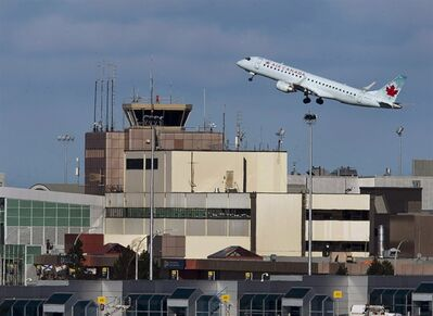 An Air Canada passenger jet takes off over Halifax Airport on Jan. 21, 2013. THE CANADIAN PRESS/Andrew Vaughan