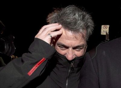 Pierre Duhaime leaves SQ headquarters in Montreal on November 28, 2012. THE CANADIAN PRESS/Graham Hughes.
