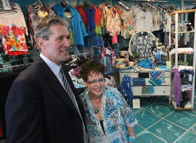 Tory Leader Brain Pallister, with small business owner Connie Hall at her store, Peppertree Fashions