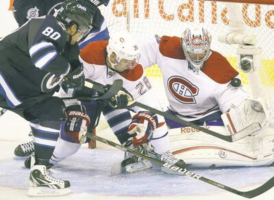 Nik Antropov scores the first goal for the new Winnipeg Jets, putting one past Montreal goalie Carey Price in Game 1 at the MTS Centre on Oct. 9.
