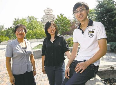 International student advisor Helen Wang with Beibei Lu and Zhibo Yang.