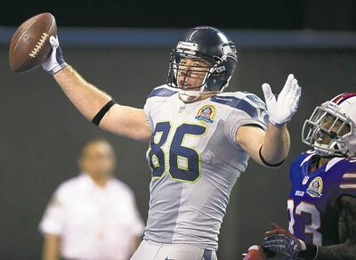 frank gunn / the canadian pressSeattle Seahawks tight end Zach Miller celebrates his touchdown reception against Buffalo at the Rogers Centre in Toronto on Sunday.