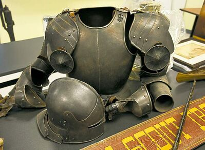 A suit of armour and an old officer's hat are among 1,300 artifacts stolen from various locations across Atlantic Canada and recovered by the RCMP. The Mounties put them on display Friday. They were found in a Halifax home and a man has been charged.   some of the hundreds of historical artifacts discovered at a suburban home, in Halifax on Friday, Jan. 25, 2013. John Mark Tillmann has been charged with possessing stolen property.THE CANADIAN PRESS/Andrew Vaughan