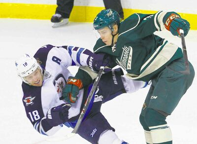 ann hesienfelt / the associated pressJets centre Bryan Little takes a hit from Minnesota Wild centre Charlie Coyle in the first period of Sunday�s 2-1 Wild win in St. Paul.