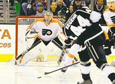 Reed Saxon  / the associated pressPhiladelphia Flyers goalie Steve Mason readies for a blast from Los Angeles KIngs defenceman Robyn Regehr in Los Angeles on Saturday. Mason has rebounded from a tough six-game stretch.