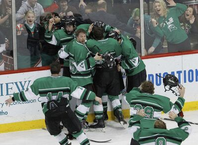 East Grand Forks players and fans celebrate after East Grand Forks defeated Hermantown in the boys' Class A state hockey tournament championship game in St. Paul, Minn., in 2015. (AP Photo/Ann Heisenfelt)</p>