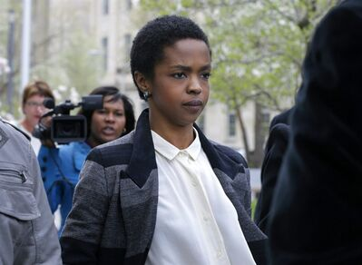 FILE - An April 22, 2013, file photo shows singer Lauryn Hill walking from federal court in Newark, N.J. Hill has started serving a three-month prison sentence in Connecticut for failing to pay about $1 million in taxes over the past decade. The Grammy-winning singer reported Monday July 8, 2013, to the federal prison in Danbury. (AP Photo/Mel Evans, file)
