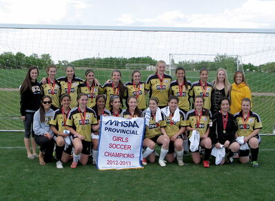 The Garden City Fighting Gophers celebrate their provincial soccer championship. The Gophers beat Dakota on an overtime goal by MVP Kailyn Balfour.