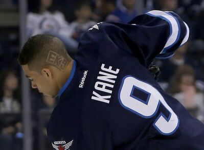 Winnipeg Jets' Evander Kane displays his personalized hairdo during a warm-up earlier this month. He wasn't in the warm-up Saturday, but played a regular shift.
