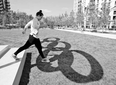 Jae C. Hong / The Associated Press Archives Yolane Kukla, a swimmer from Australia, walks off the steps of the Olympic rings at the Athletes� Village in London.