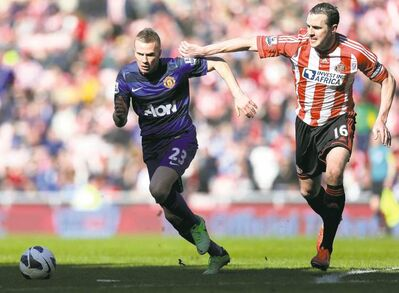 Scott Heppell / the associated pressManchester United�s Tom Cleverley (left)  tries to elude Sunderland captain John O�Shea during their Premier League match at the Stadium of Light Saturday afternoon.