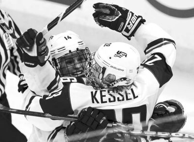 American Brianna Decker races to congratulate Amanda Kessel on her two-on-one game winner in the third period Tuesday.