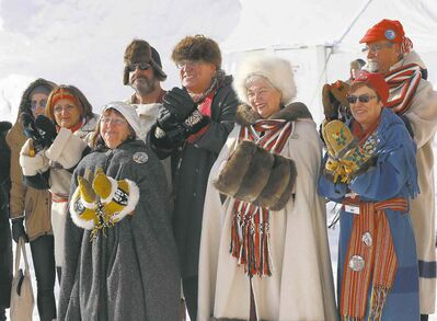 Festival du Voyageur ambassadors in traditional costumes welcome one and all to come visit.