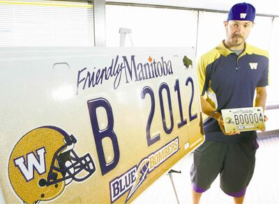 Winnipeg Blue Bombers QB Buck Pierce,unveils generation two Winnipeg Blue Bomber plates- The new plates will cost $70 and 5000 of them will be made available May 28, 2012 at 300 Autopac agents-See Paul Wiecek story- May 22, 2012   (JOE BRYKSA / WINNIPEG FREE PRESS)