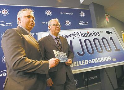 Ken Gigliotti / Winnipeg Free Press filesTrue North Foundation executive director Dwayne Green (left)  and Manitoba Premier Greg Selinger  announce the raffle of the first printed Jets specialty licence plate in April 2013.