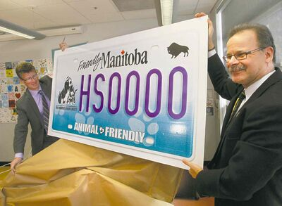 Wayne Glowacki / Winnipeg Free PressBill McDonald of the Winnipeg Humane Society (right) and Andrew Swan, minister responsible for MPI, unveiled the new Winnipeg Humane Society specialty licence plate Friday. The plates will be available April 1 at a cost of $70, with $30 going toward the humane society.