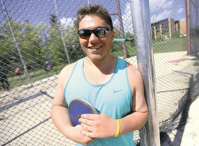 Justin Krantz from Goose Lake High School in Roblin, Manitoba, poses with a discuss during the MHSAA Track and Field Championships at the University of Manitoba, Saturday, June 7, 2014. (TREVOR HAGAN/WINNIPEG FREE PRESS) for kyle edwards story