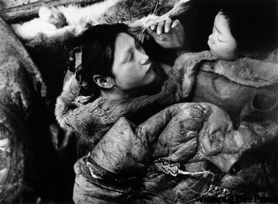 Two girls asleep under caribou skins during the famine in 1950, Padlei, NWT.
