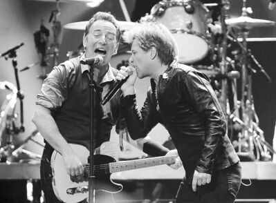 Dave Allocca / The Associated PressBruce Springsteen (left) and Jon Bon Jovi perform in the benefit concert at Madison Square Garden.