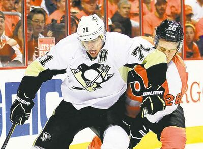 Pittsburgh Penguins' Evgeni Malkin, left, elbows Philadelphia Flyers' Erik Gustafsson in the face as they chase the puck during the first period in Game 6 of an NHL hockey Stanley Cup first-round playoff series, Sunday, April 22, 2012, in Philadelphia. The Flyers won 5-1 and won the series to advance. (AP Photo/Tom Mihalek)