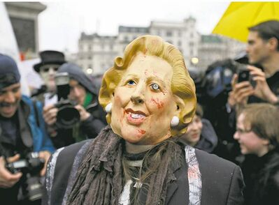 Lefteris Pitarakis / The Associated Press The late British prime minister Margaret Thatcher is reviled during a party in London's Trafalgar square Saturday to mark her death.