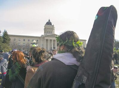 DAVID LIPNOWSKI / WINNIPEG FREE PRESS   Thousands of people attend 4/20 to celebrate cannabis at the legislative building Saturday. Those in attendance cited a recent movement among U.S. states to decriminalize marijuana in Washington and Colorado as progress.