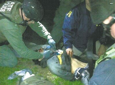 The Associated PressAgents check Dzhokhar Tsarnaev for explosives and also give him medical attention after he was apprehended in Watertown, Mass.