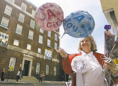Royal supporter Margaret Tyler is hedging her bets in front of St Mary's Hospital in London. Prince William and his wife don't know the sex of their baby.