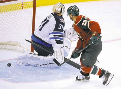 Jason Pominville pots the OT winner behind Ondrej Pavelec.