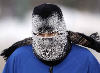 Fred Allen jogs along Wellington Crescent Sunday in -28 C weather. That's what you call dedication.