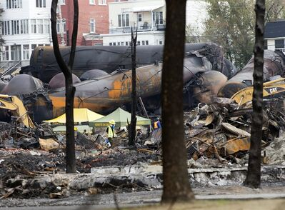 Work continues at the crash site of the train derailment and fire Tuesday, July 16, 2013 in Lac-Megantic, Que. that left 37 people confirmed dead and another 13 missing and presumed dead.THE CANADIAN PRESS/Ryan Remiorz