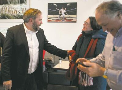 NDP Leader Tom Mulcair (left) chats with people at the Free Press News Caf�� Saturday. Mulcair says the party must reach out to the Prairie provinces and to young people.