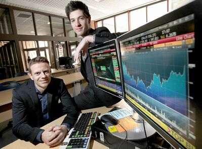 Nathan Moncrief (left) and Josh Olfert at the University of Manitoba's Asper School of Business. They've become successful investors at a young age.