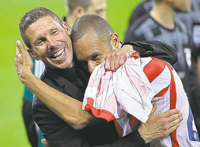 Atletico Madrid coach Diego Simeone (left).