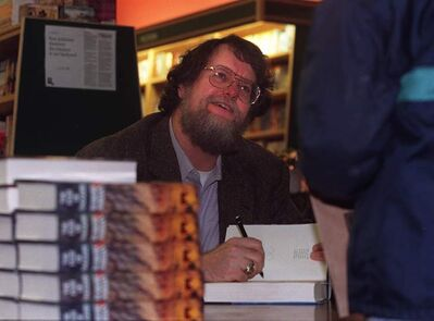 Robert Jordan signs books at McNally Robinson Booksellers in 1998.