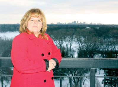 Edgewood Estates leasing manager Suzan Stupack is shown on the balcony of one of the complex's 11th-floor suites.
