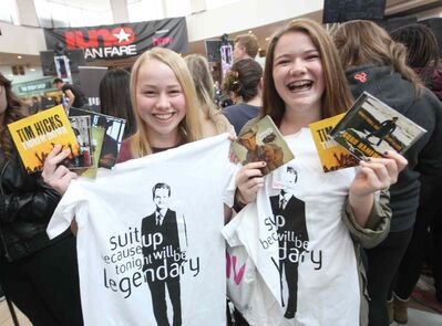Seventeen-year-old Richelle Peters (left) and her friend Shianne Johnson, 16, waited patiently near the front of the stage at centre court at St. Vital Centre for three hours Saturday with their CD's and shirts waiting for their favourite country artists to hit the stage at Juno Fan Fare.
