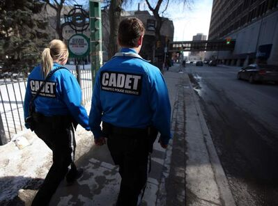 Police service cadets Erin Brolly (left) and Daniel Popel walk a downtown beat Monday. Downtown patrols started in 2006 and remove many intoxicated people.