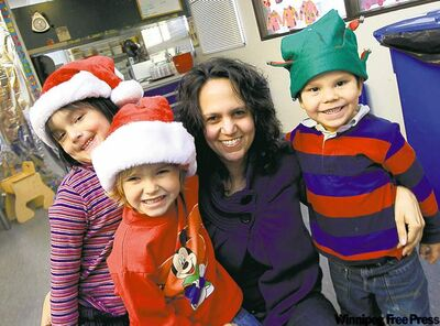 Bobbette Shoffner, the nursery's director of early learning, with a few of her charges (from left)  Alesha, 5, Crystal, 4 and Roulin, 4.
