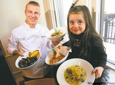 Head chef Darryl Crumb poses with Brooklynn Bistro's namesake, Brooklynn Colosimo.
