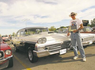 2012 Cruiser of the Year Adriene Poirier with his prized 1958 Meteor. Poirier volunteers countless hours each year to the cruising hobby