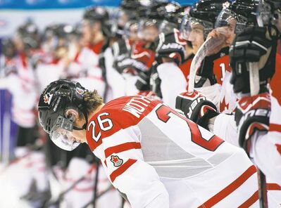 Nathan Denette / the canadian pressBlue-liner Tyler Wotherspoon despairs after the Canadians were manhandled by the Americans during semifinal action at the world junior championship.